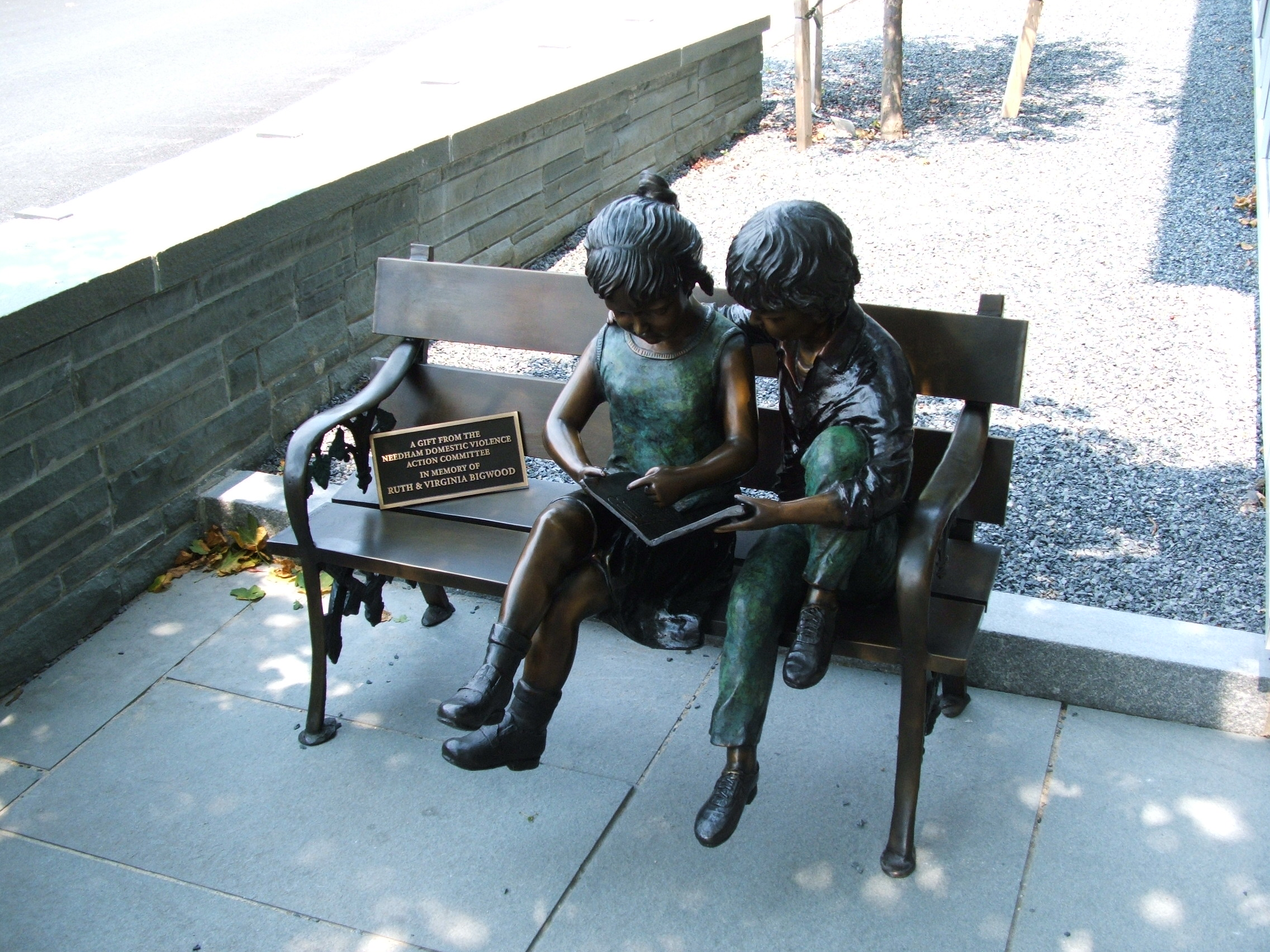 Two Children Reading on a Bench Statue